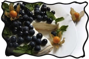 Pavlova cake with grapes and physalis