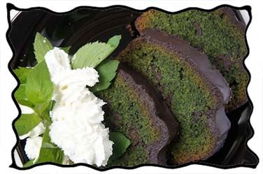 Slices of mint chocolate cake and whipped cream
