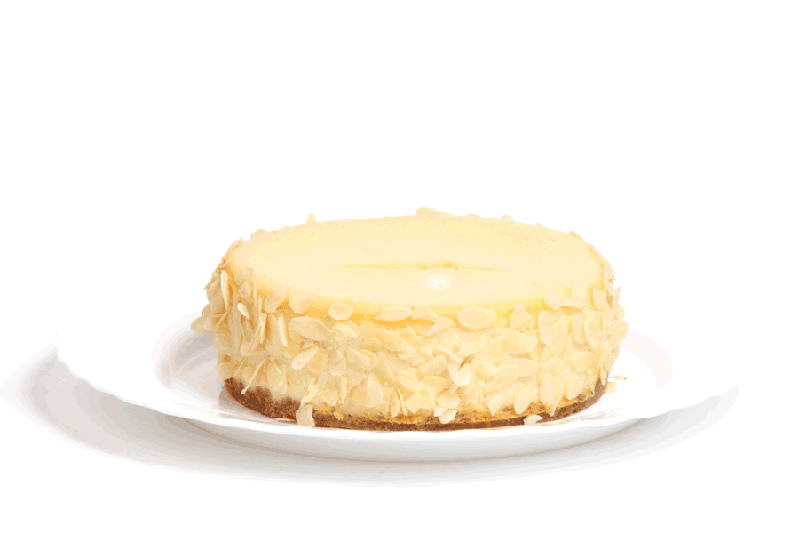 New York cheesecake decorated with almond slices