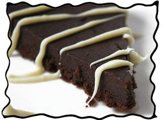 Slice of flourless dark chocolate cake