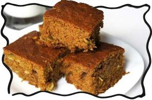 Carrot cake square pieces with pumpkin seeds