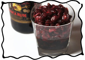 Soaking dried cherries in rum for the filling