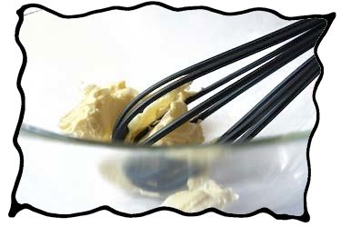 Whisking the softened butter