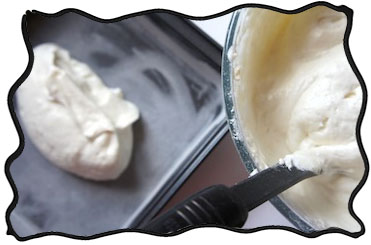 Putting angel food cake batter into the form