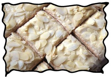 Angel food cake squares with almond slices