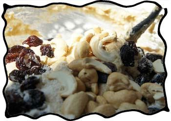 The tastiest part: folding in raisins and nuts!